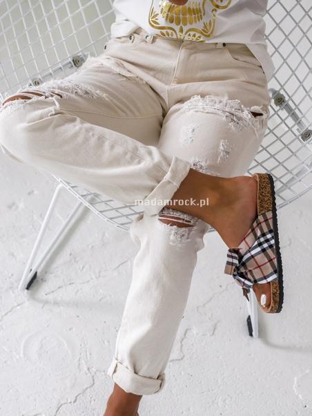 Spodnie z przetarciami typu...