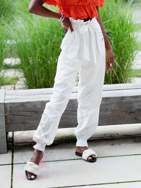 Spodnie chinosy haftowane...